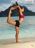 Kimberly Snyder practicing yoga.